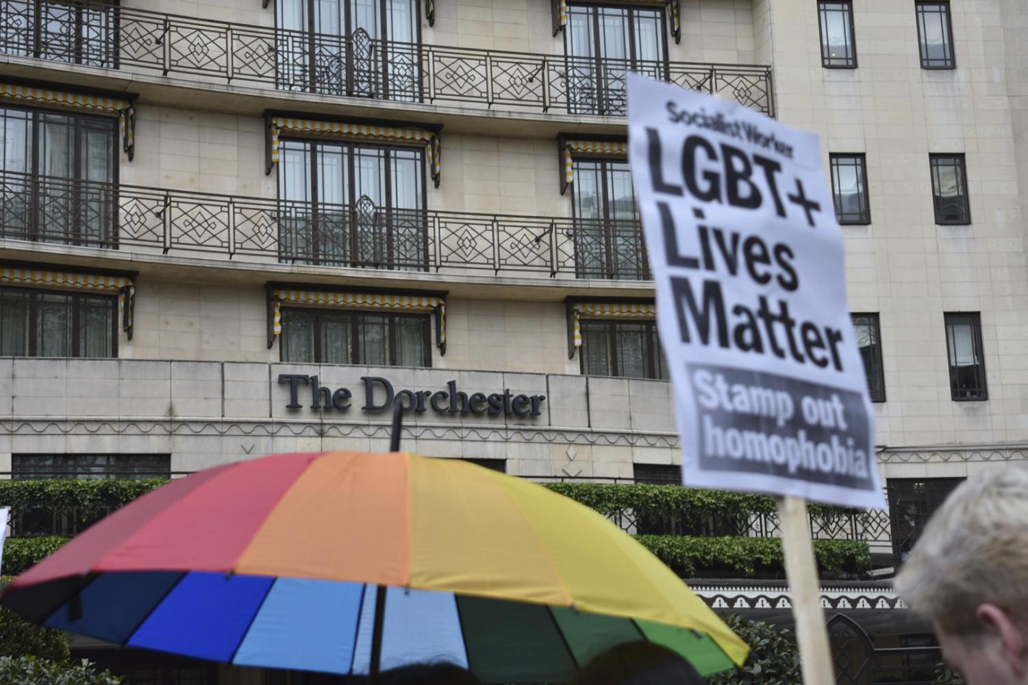 Protestors outside The Dorchester hotel on Park Lane in London, demonstrating against the Brunei anti-gay laws, Saturday April 6, 2019. Protesters gather outside the hotel owned by the Sultan of Brunei, to decry Islamic laws in the Southeast Asian nation of Brunei that punish gay sex and adultery by stoning offenders to death. (Sophie Hogan/PA via AP)