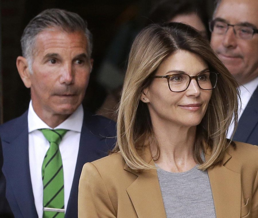 Actress+Lori+Loughlin%2C+front%2C+and+husband%2C+clothing+designer+Mossimo+Giannulli%2C+left%2C+depart+federal+court+in+Boston+after+facing+charges+in+a+nationwide+college+admissions+bribery+scandal.+On+Tuesday%2C+April+9%2C+Loughlin+and+Giannulli+were+among+16+prominent+parents+indicted+on+an+additional+charge+of+money+laundering+conspiracy+in+the+case.+%28AP+Photo%2FSteven+Senne%2C+File%29