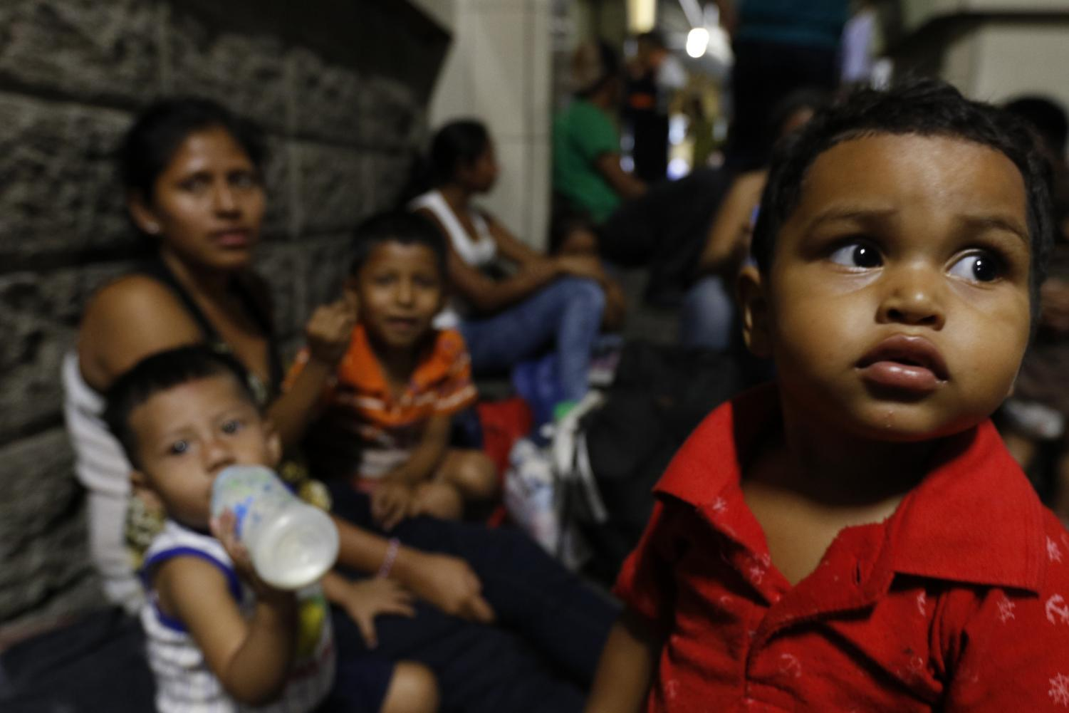 Migrants planning to join a new caravan of several hundred people wait in San Pedro Sula, Honduras, Tuesday, April 9, 2019. Advocates warn that if the Trump administration cuts aid to Central American countries like Honduras, the humanitarian crisis in these regions will only grow.