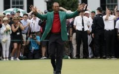 COMMENTARY: A reformed, more human Tiger Woods does the impossible
