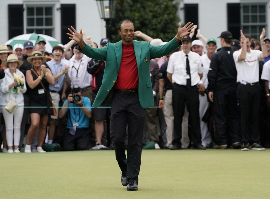 Tiger Woods addresses a massive gallery around the 18th green at Augusta National Golf Club after winning his 15th major title.