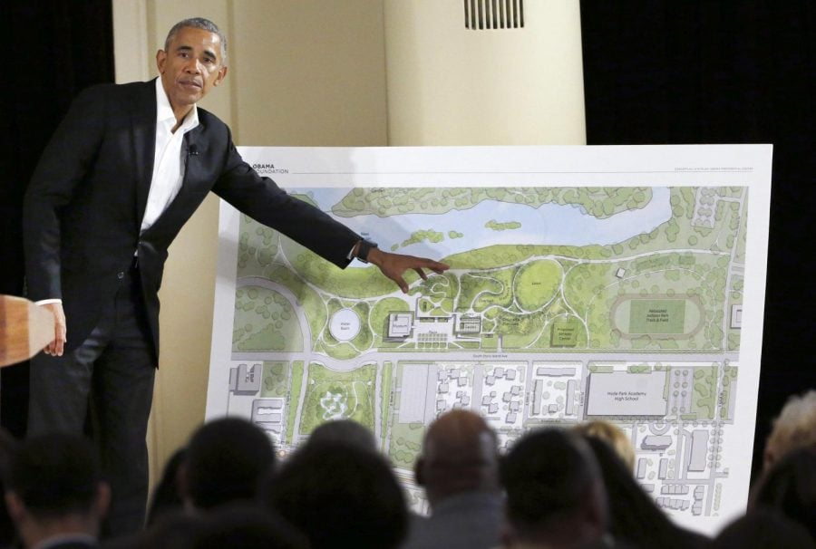 In this May 3, 2017, file photo, former President Barack Obama speaks near a rendering for the former president's lakefront presidential center at a community event on the Presidential Center at the South Shore Cultural Center in Chicago. Obama's foundation collected contributions of more than $1 million from 11 firms and individuals in the first three months of 2019, records show. The Obama Foundation's donor list, which is updated quarterly, included the AT&T Foundation and the W.K. Kellogg Foundation on Monday, along with other family trusts and foundations. The list also included foreign investors like Malaysian businessman Tony Fernandes, who is chief executive of AirAsia, and Rumi Verjee, who is a member of the British House of Lords.