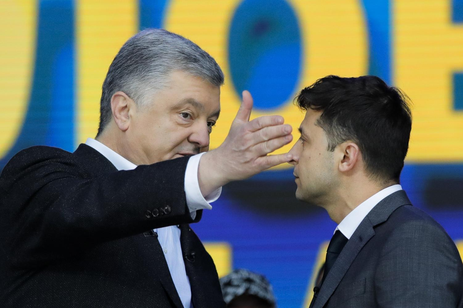 Ukrainian presidential candidate and popular comedian Volodymyr Zelenskiy, right, watches as Ukrainian President Petro Poroshenko gestures during their final electoral campaign debate at the Olympic stadium in Kiev, Ukraine, Friday, April 19, 2019. Friday is the last official day of election canvassing in Ukraine as all presidential candidates and their campaigns will be barred from campaigning on Saturday, the day before the vote.