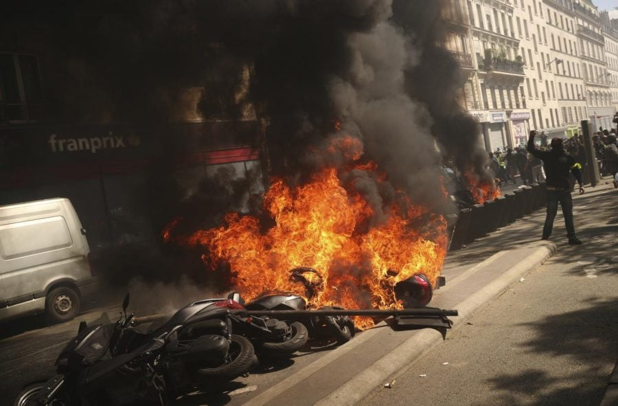 A+set+of+motorbikes+are+set+alight+during+a+yellow+vest+demonstration+in+Paris%2C+Saturday%2C+April+20%2C+2019.+French+yellow+vest+protesters+are+marching+anew+to+remind+the+government+that+rebuilding+the+fire-ravaged+Notre+Dame+Cathedral+isn%27t+the+only+problem+the+nation+needs+to+solve.