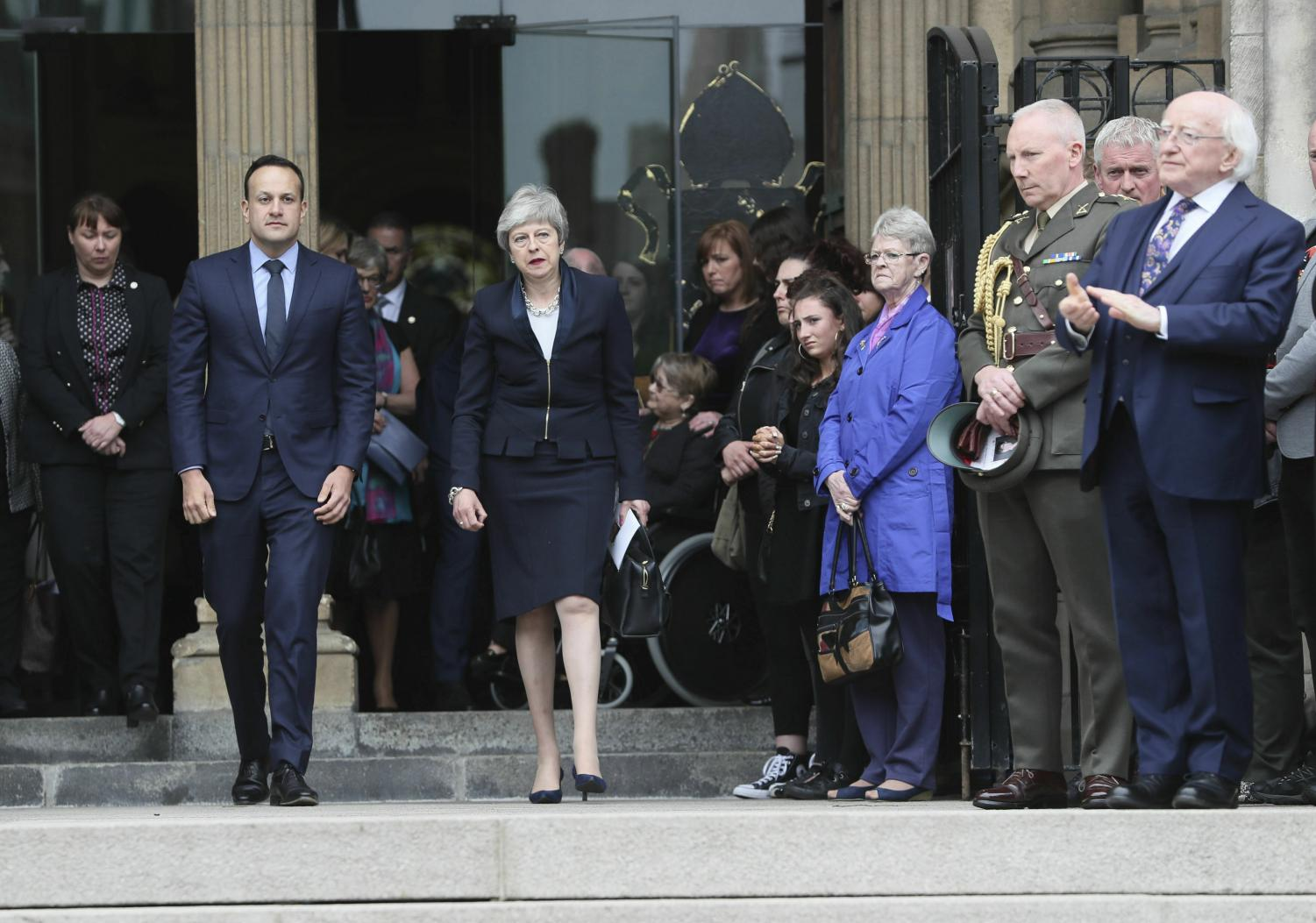 Britain's Prime Minister Theresa May, centre and Ireland Prime Minister Leo Varadkar leave after the funeral service of journalist Lyra McKee, at St Anne's Cathedral in Belfast, northern Ireland, Wednesday April 24, 2019. The leaders of Britain and Ireland joined hundreds of mourners Wednesday at the funeral of Lyra McKee, the young journalist shot dead during rioting in Northern Ireland last week.