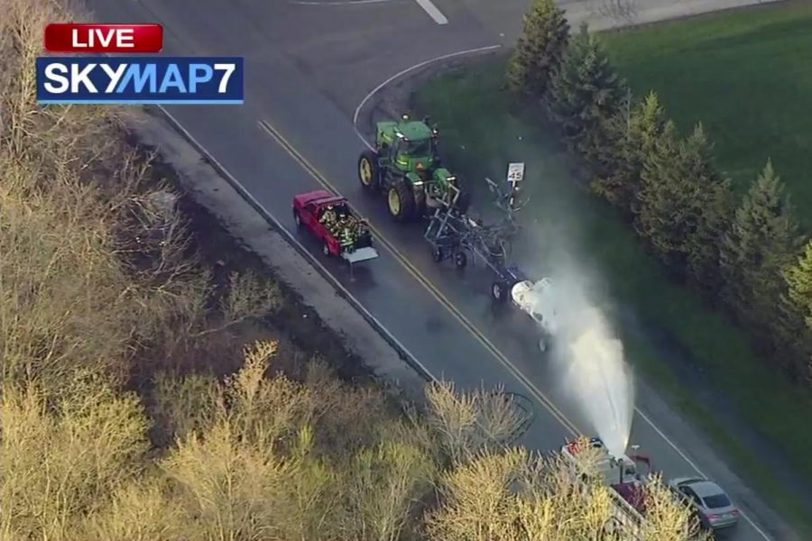 In+this+still+image+from+video+provided+by+ABC7+Chicago%2C+a+fire+engine+sprays+water+on+a+container+of+the+chemical+that+farmers+use+for+soil+after+after+anhydrous+ammonia+leaked+Thursday%2C+April+25%2C+2019%2C+in+Beach+Park%2C+Ill.+Authorities+say+dozens+of+people+have+been+taken+to+hospitals+after+anhydrous+ammonia+leaked+from+containers+that+a+tractor+was+pulling+in+the+Chicago+suburb.
