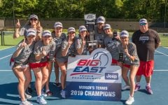 The DePaul women's tennis team pose for a picture together after winning the Big East Tournament championship. The Blue Demons defeated Xavier 4-3 in the final on April 22 in South Carolina.
