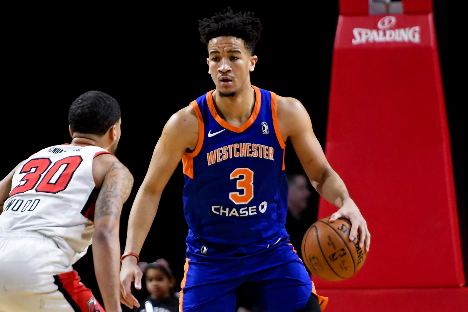 Former DePaul basketball player Billy Garrett Jr. brings up the ball for the Westchester Knicks during a game this season.