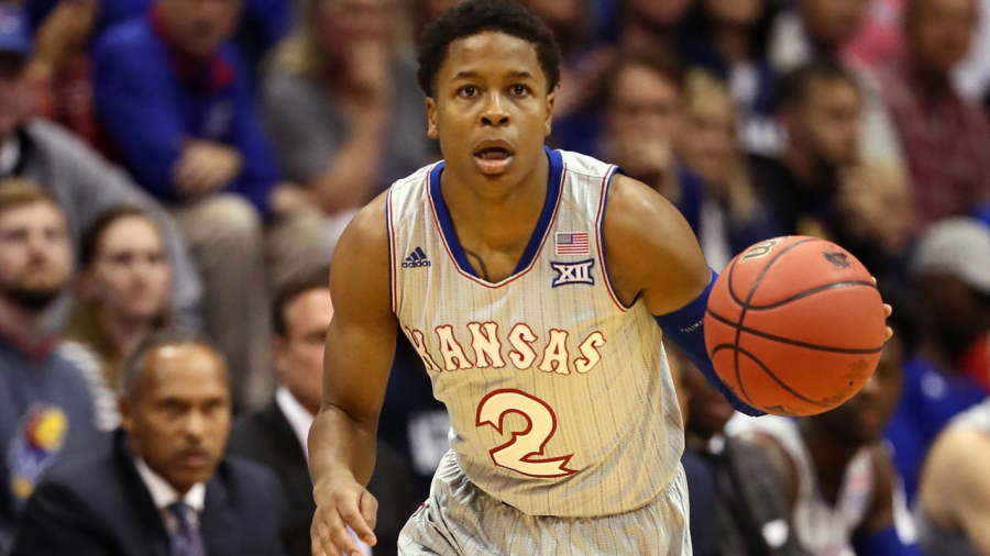 Charlie+Moore+brings+up+the+ball+for+Kansas+earlier+this+season.+Moore+announced+his+transfer+from+Kansas+to+DePaul+on+April+22.+