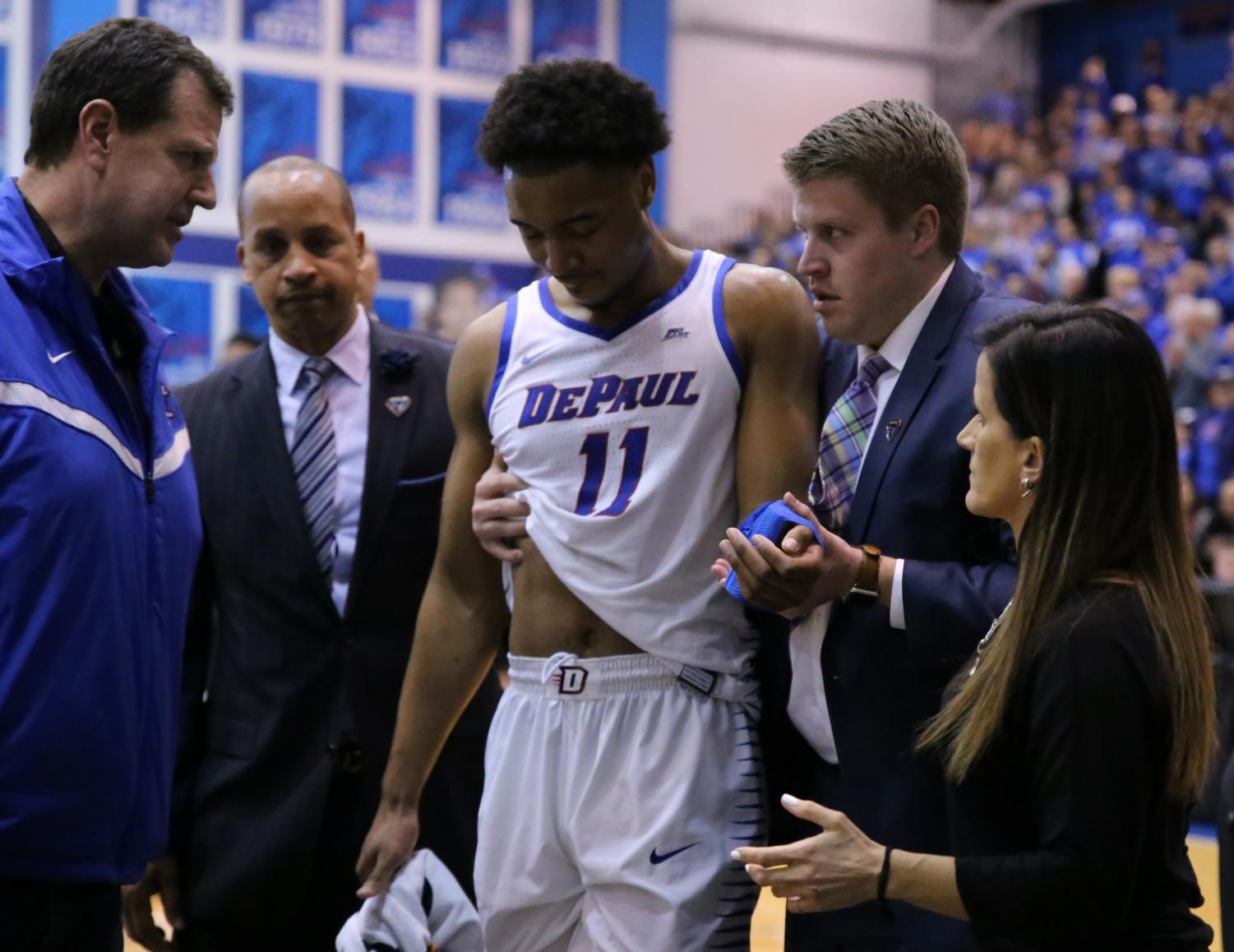 DePaul+senior+Eli+Cain+is+helped+off+the+court+after+injuring+his+hand+during+the+first+half+of+game+two+of+the+CBI+championship+at+McGrath-Phillips+Arena+Wednesday+night.+Alexa+Sandler+%7C+The+DePaulia