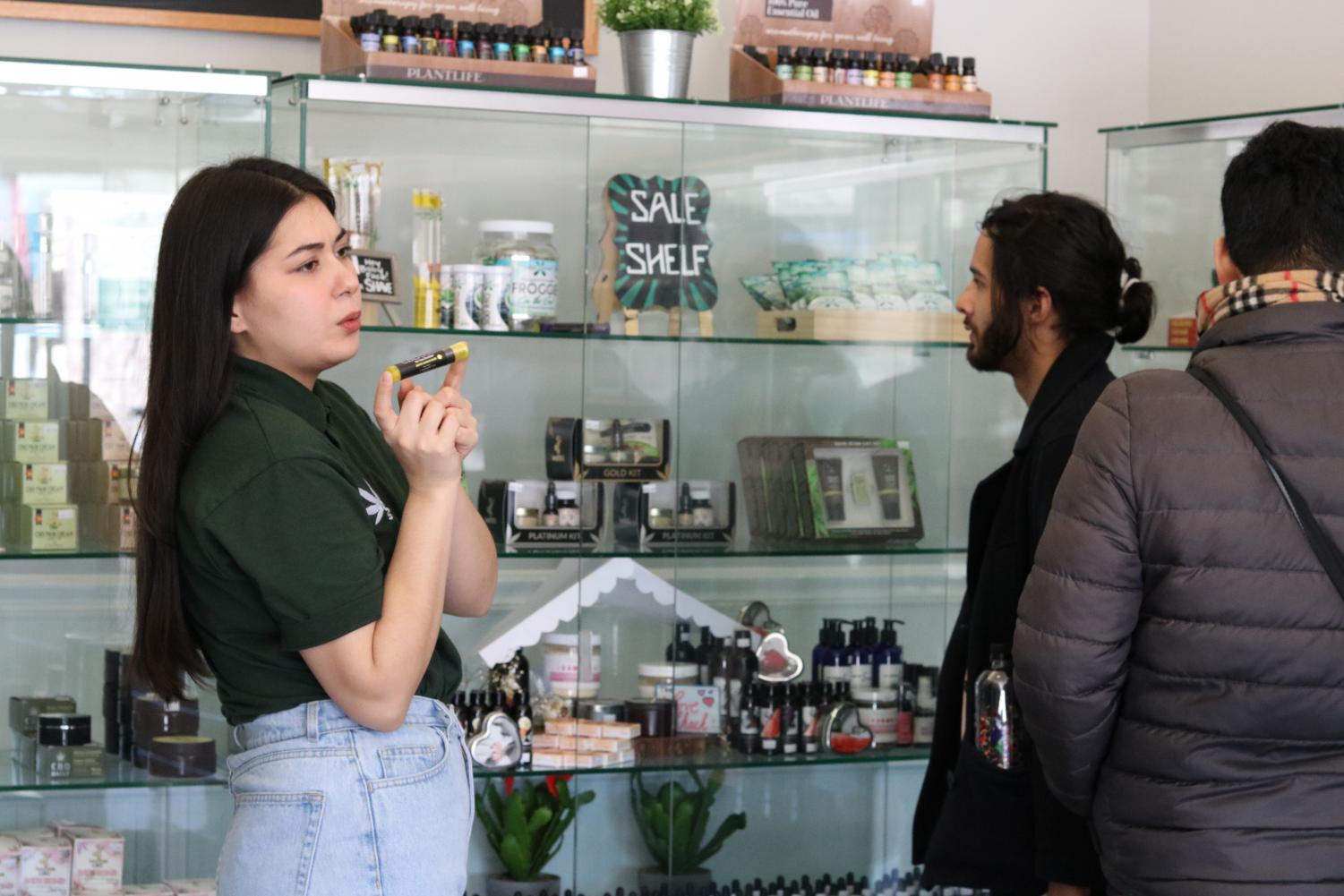 Danielle Larson, manager of CBD Kratom in Lakeview, gives customers the sales pitch on the store's products.