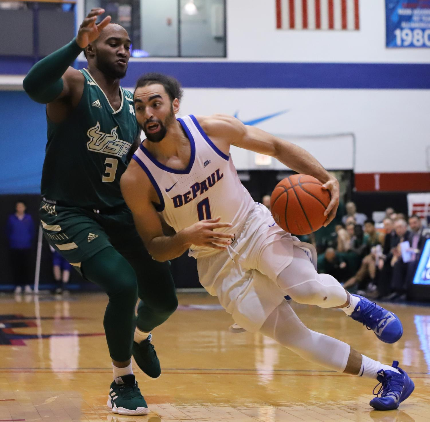 DePaul+junior+Lyrik+Shreiner+drives+to+the+basket+against+USF+guard+Laquincy+Rideau+during+the+Blue+Demons+100-96+victory+in+game+two+of+the+CBI+finals.+Shreiner+finished+with+seven+points+and+seven+assists.+Alexa+Sandler+%7C+The+DePaulia