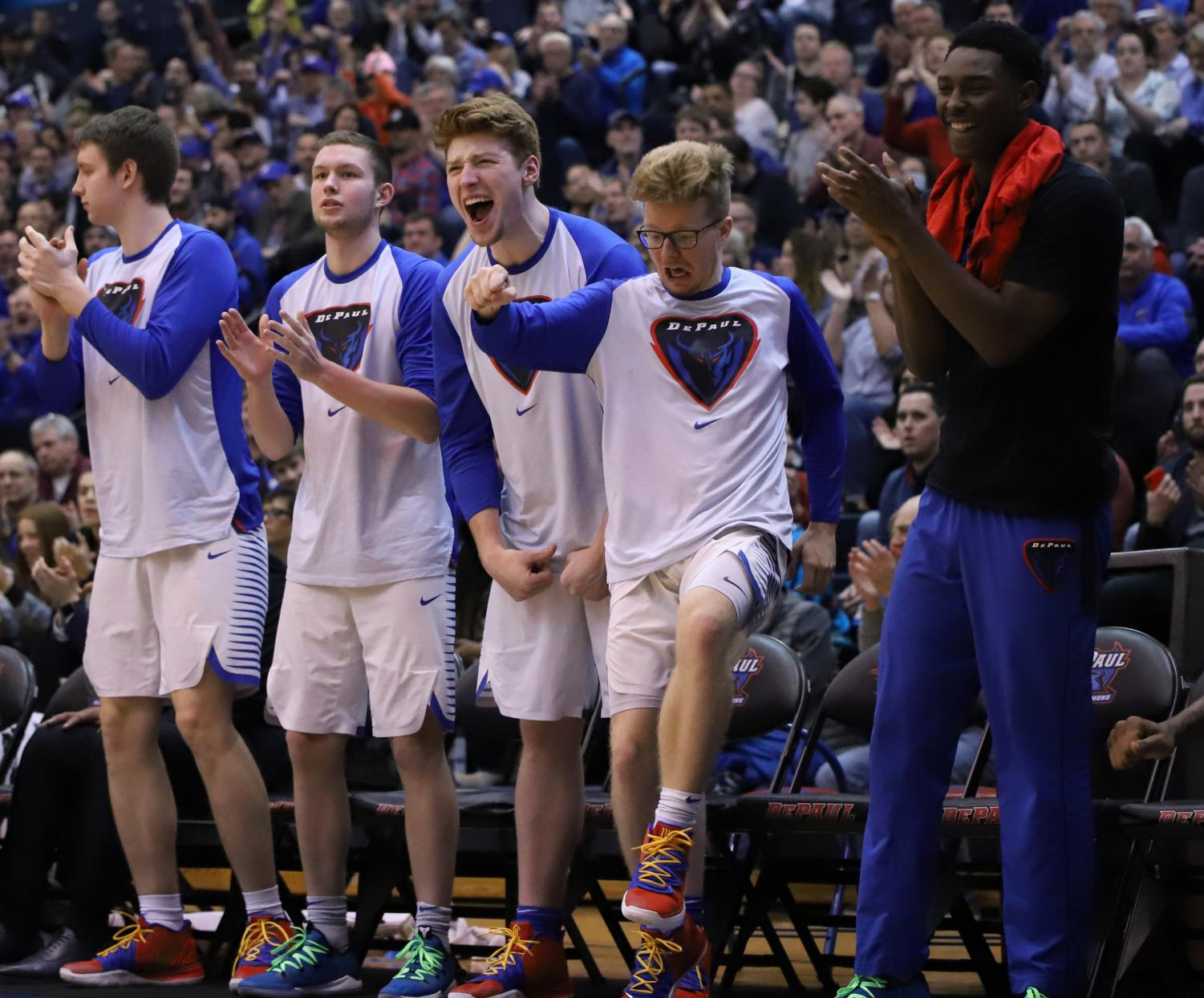 (Left to right) George Maslennikov, John Diener, Mick Sullivan, Pantelis Xidias and Jalen Coleman-Lands react to a play during DePaul's victory over USF Wednesday night at McGrath-Phillips Arena. The Blue Demons won the game 100-96. Alexa Sandler | The DePaulia