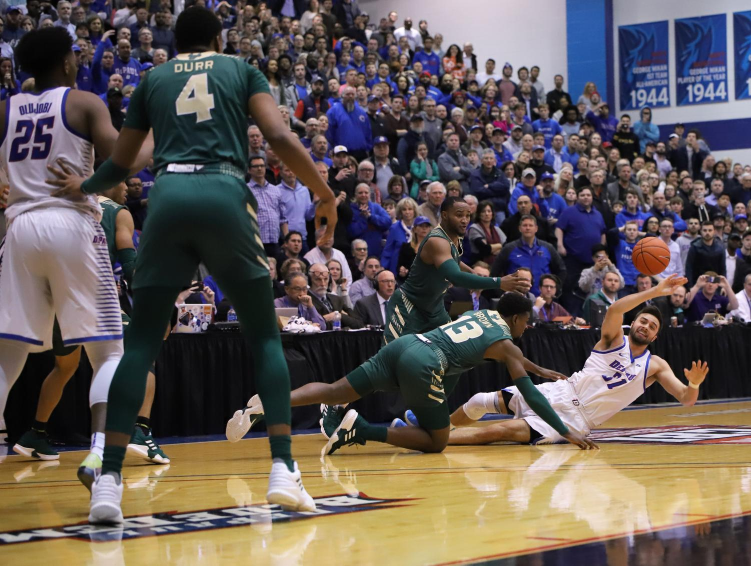 DePaul+senior+guard+Max+Strus+tries+to+save+the+ball+late+in+regulation+after+having+it+knocked+away+by+USF+defenders+Laquincy+Rideau+and+Justin+Brown.+The+Blue+Demons+and+Bulls+headed+to+overtime+tied+at+82.+Alexa+Sandler+%7C+The+DePaulia
