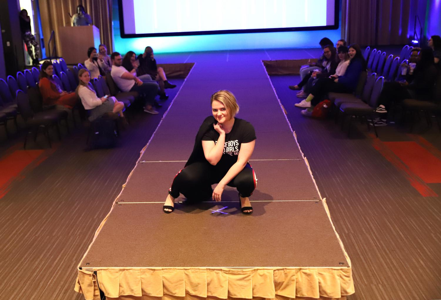 A volunteer from the crowd poses during the DePaul Fashion Show at the Student Center. The Fashion Show was organized by DePaul's Fashion Society.