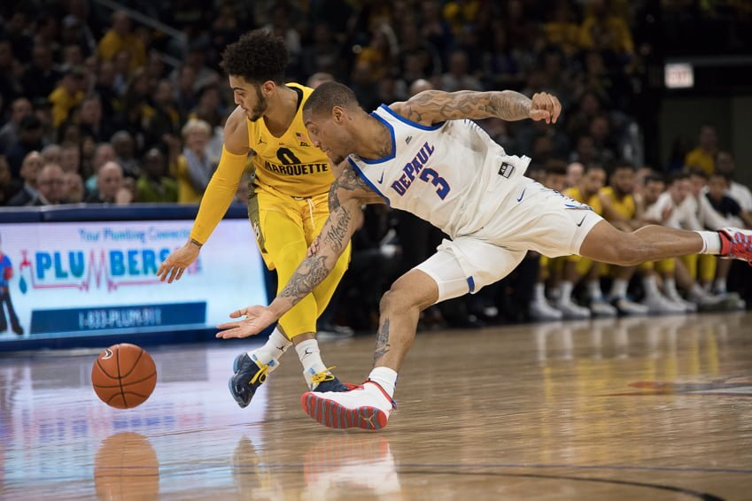 DePaul sophomore Devin Gage and Marquette junior Markus Howard fight for a loose ball at Wintrust Arena on Feb. 12.