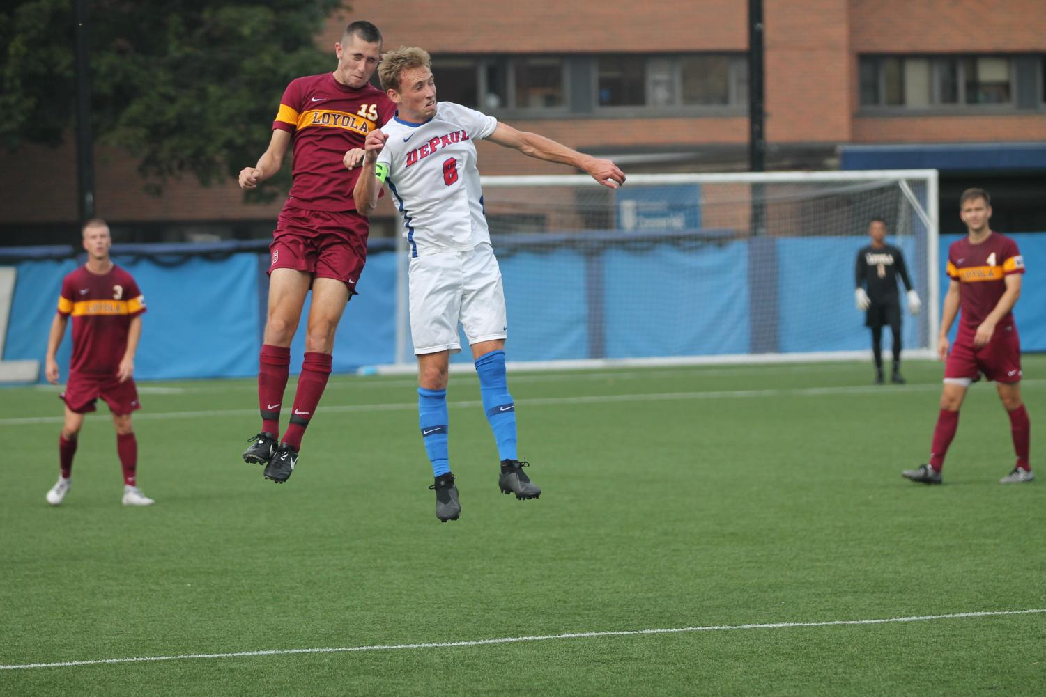 DePaul senior Harry Hilling and Loyola Connor Stevenson go up for a header in their game at Wish Field on Sep. 18, 2018. The Blue Demons lost that game 1-0 in overtime.
