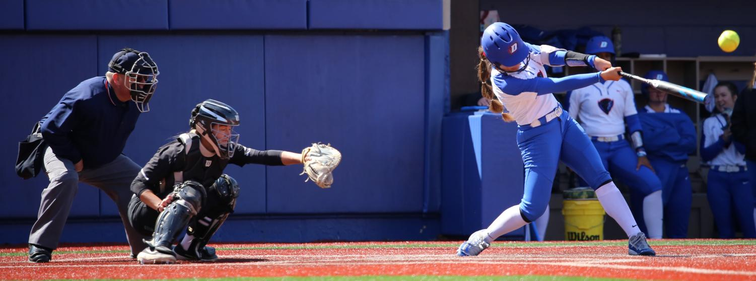 DePaul sophomore infielder Maranda Guiterrez hits her second home run of against Providence on Saturday. The Blue Demons won both games on Saturday 8-0 and 8-2.
