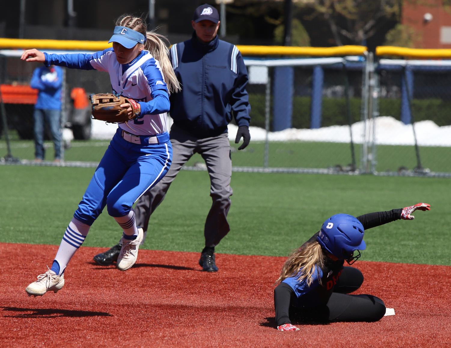 DePaul junior Madison Fisher slides into second base during DePaul's game against Creighton at Cacciatore Stadium on Sunday.