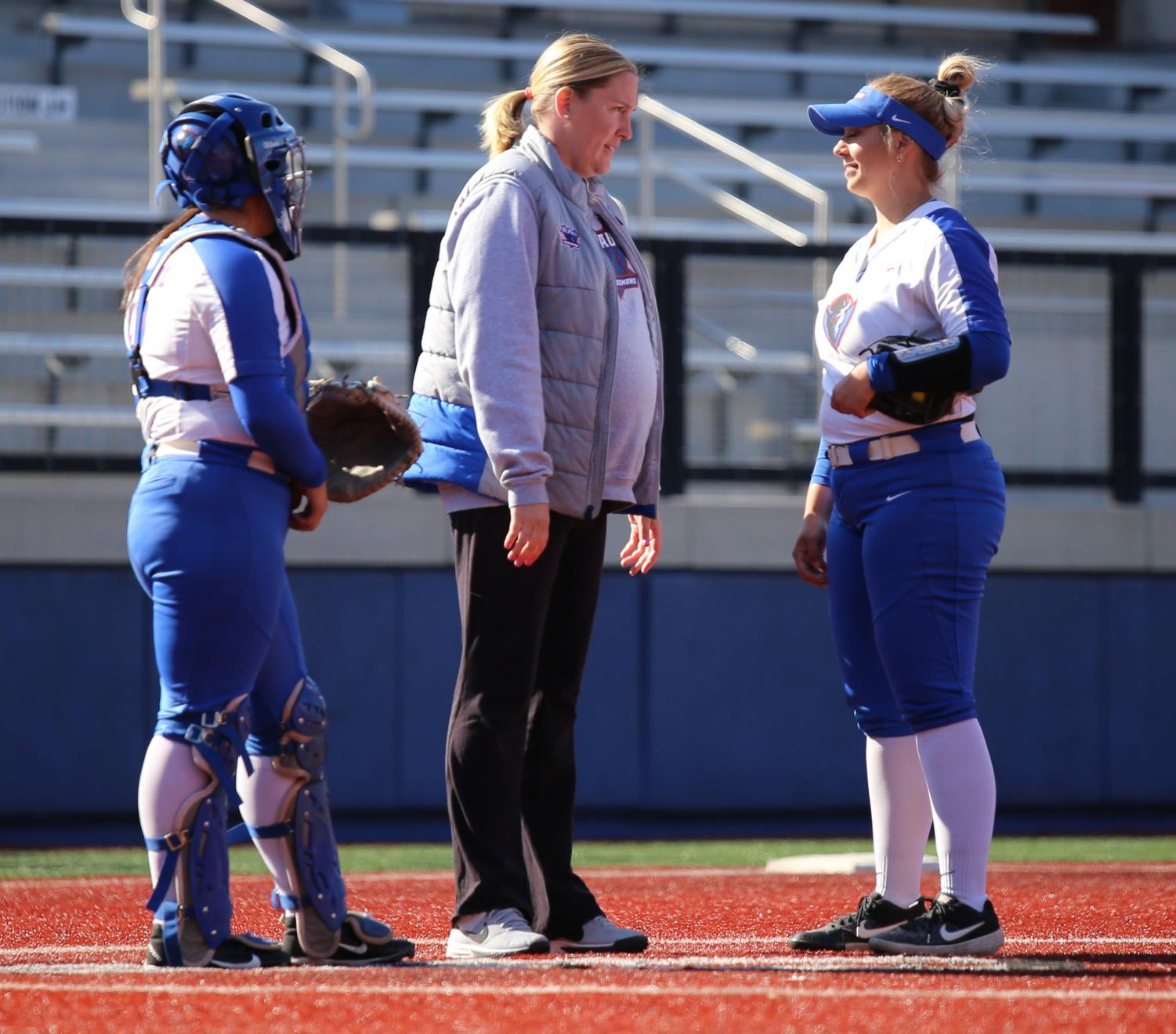 DePaul head coach Tracie Adix-Zins visits the mound to talk with her sophomore pitcher Natalie Halvorson during the second game of a double-header with Providence on Saturday at Cacciatore Staduim. The Blue Demons won both games against the Friars.