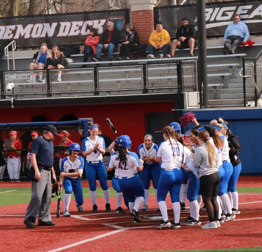 The+DePaul+softball+team+celebrates+at+home+plate+after+the+game+winning+run+was+driven+in+extra+innings.+DePaul+defeated+Illinois+State+6-5+on+Tuesday+at+Cacciatore+Staduim+Maria+Guerrero%2F+The+DePaulia