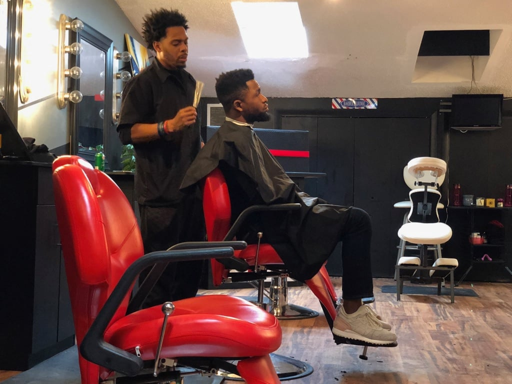 Thomas getting ready to treat Ola to a haircut inside of the haircut section of his studio in Lincoln Park, on Feb. 2, 2019.