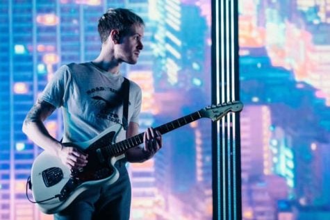 The 1975's guitarist Adam Hann on stage during their show in Milwaukee on May 10. This marks the band's first show in the Midwest in nearly three years.