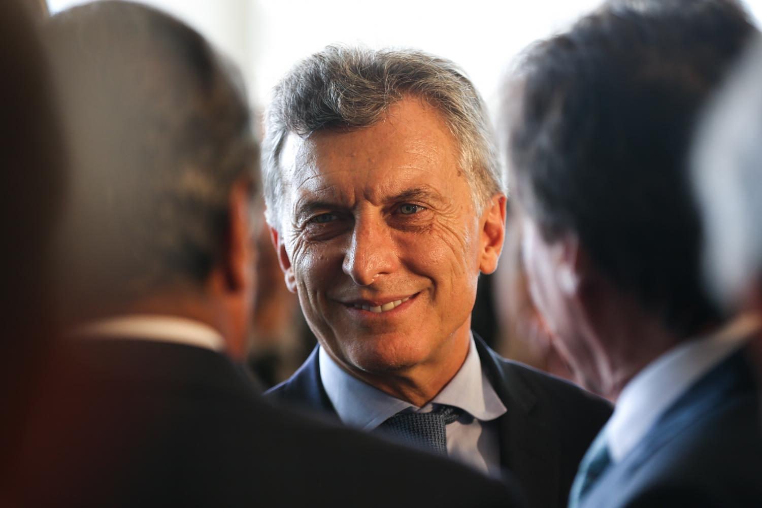 Argentina's president, Mauricio Macri, is received in Brazil on Feb. 7, 2017. The Argentine peso closed at an all-time low April 26 amid an economic crisis spurred on by inflation and high unemployment.
