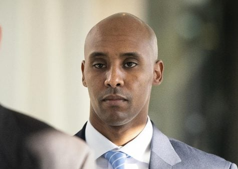 In this Friday, April 26, 2019, file photo, former Minneapolis police officer Mohamed Noor walks to court in Minneapolis. The city of Minneapolis is paying $20 million to settle a lawsuit over Noor's fatal shooting of the unarmed Justine Ruszczyk Damond, who approached his squad car after calling 911 to report a possible crime. Mayor Jacob Frey announced the settlement Friday, three days after a jury convicted Noor of murder and manslaughter in the 2017 death of Damond. Frey called the settlement