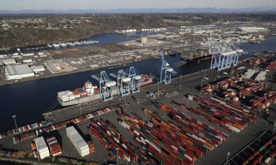 In this March 5, 2019, file photo, cargo containers are staged near cranes at the Port of Tacoma, in Tacoma, Wash. China has announced tariff hikes on $60 billion of U.S. goods in retaliation for President Donald Trump's escalation of a fight over technology and other trade disputes. The Finance Ministry said Monday, May 13, the penalty duties of 5% to 25% on hundreds of U.S. products including batteries, spinach and coffee take effect June 1.