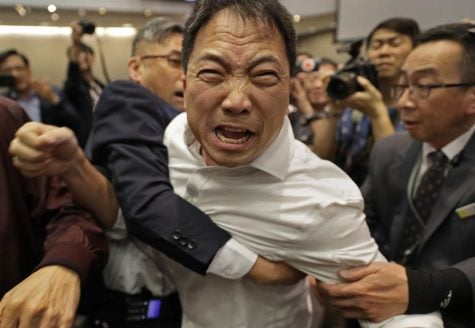 Hong Kong legislature brawl shows deep divisions over extradition law