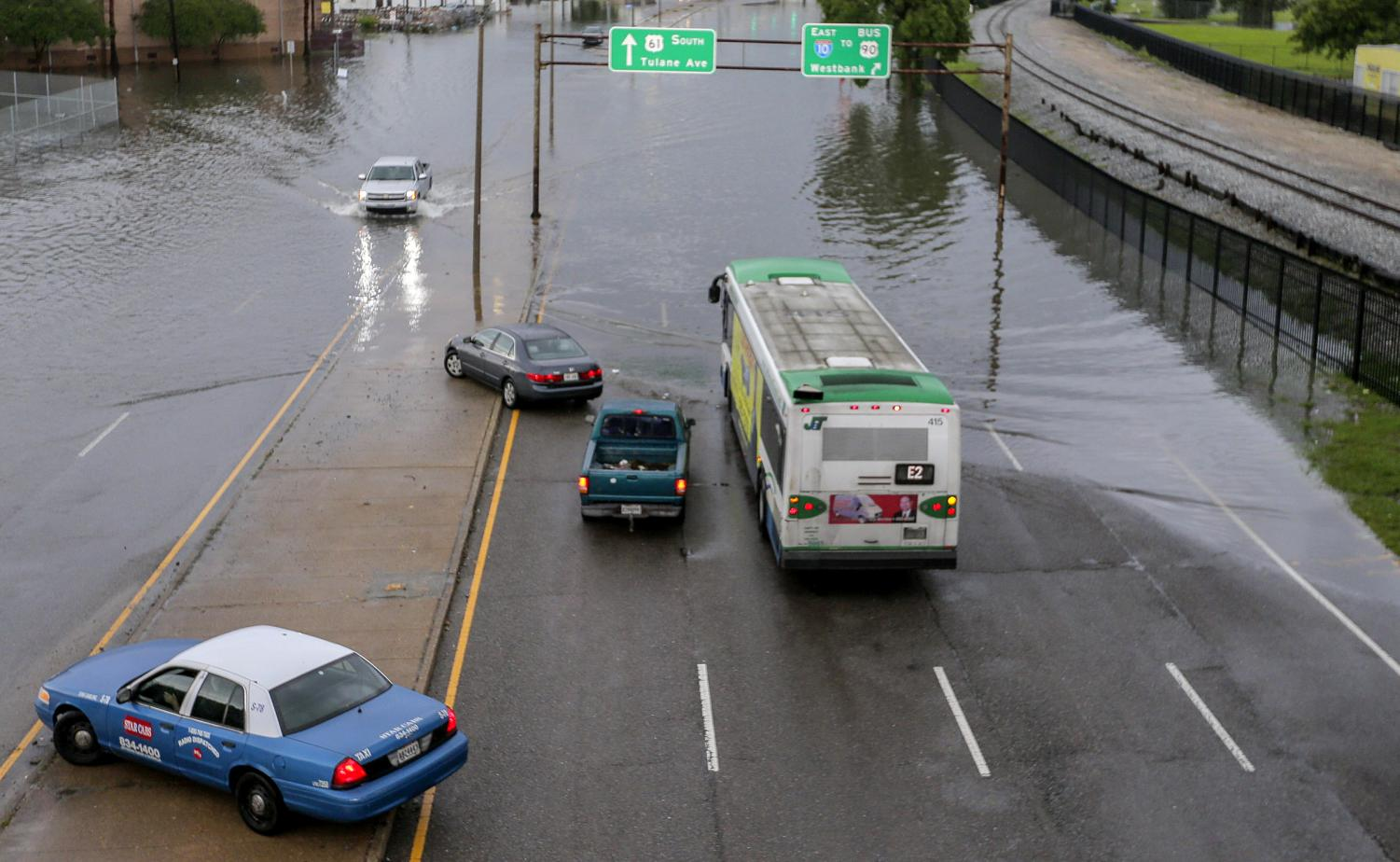 Parts of Airline Highway is covered with water in New Orleans Sunday, May 12, 2019. New Orleans residents awoke to flooded streets Sunday and the Mississippi Highway Patrol closed part of a highway due to heavy rains that also may have contributed to a freight train derailment.