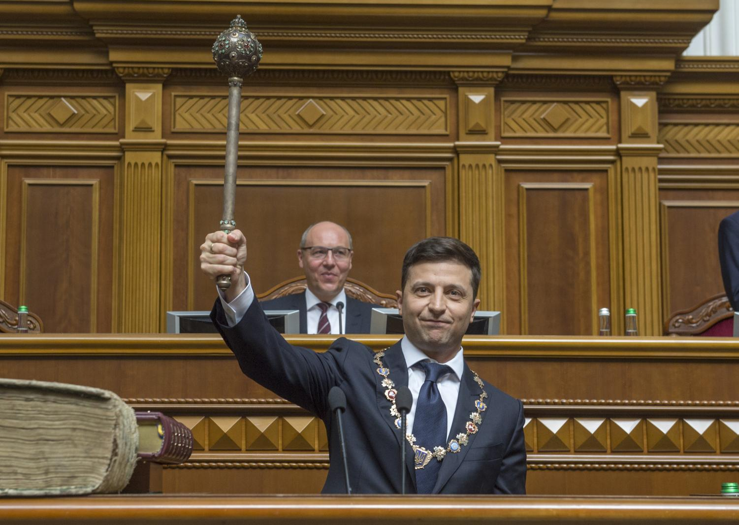 The new Ukrainian President Volodymyr Zelensky holds up a mace, the Ukrainian symbol of power, during his inauguration May 20, 2019.
