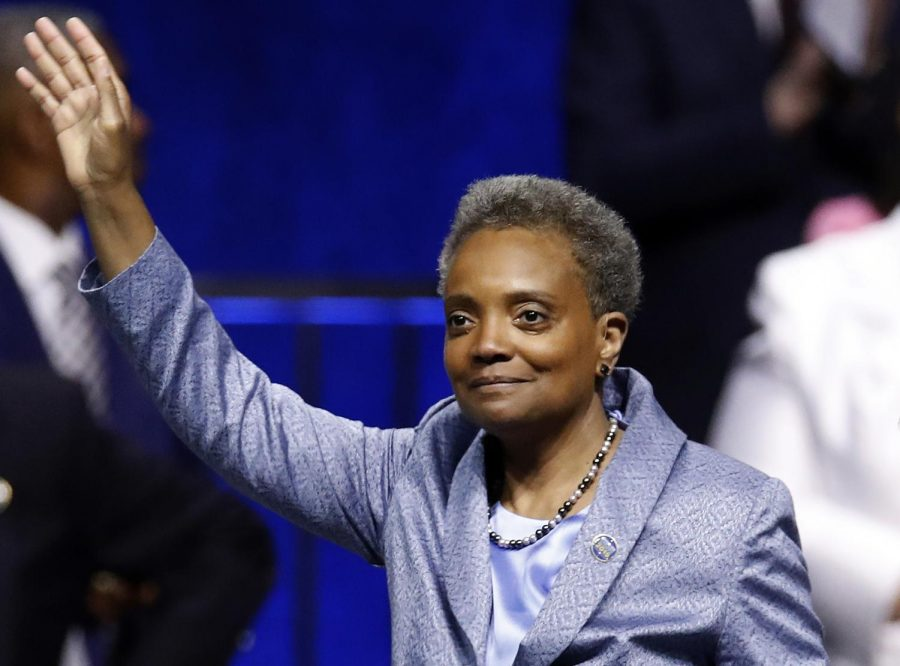 Mayor of Chicago Lori Lightfoot waves after being sworn in during her inauguration ceremony Monday, May 20, 2019, in Chicago.