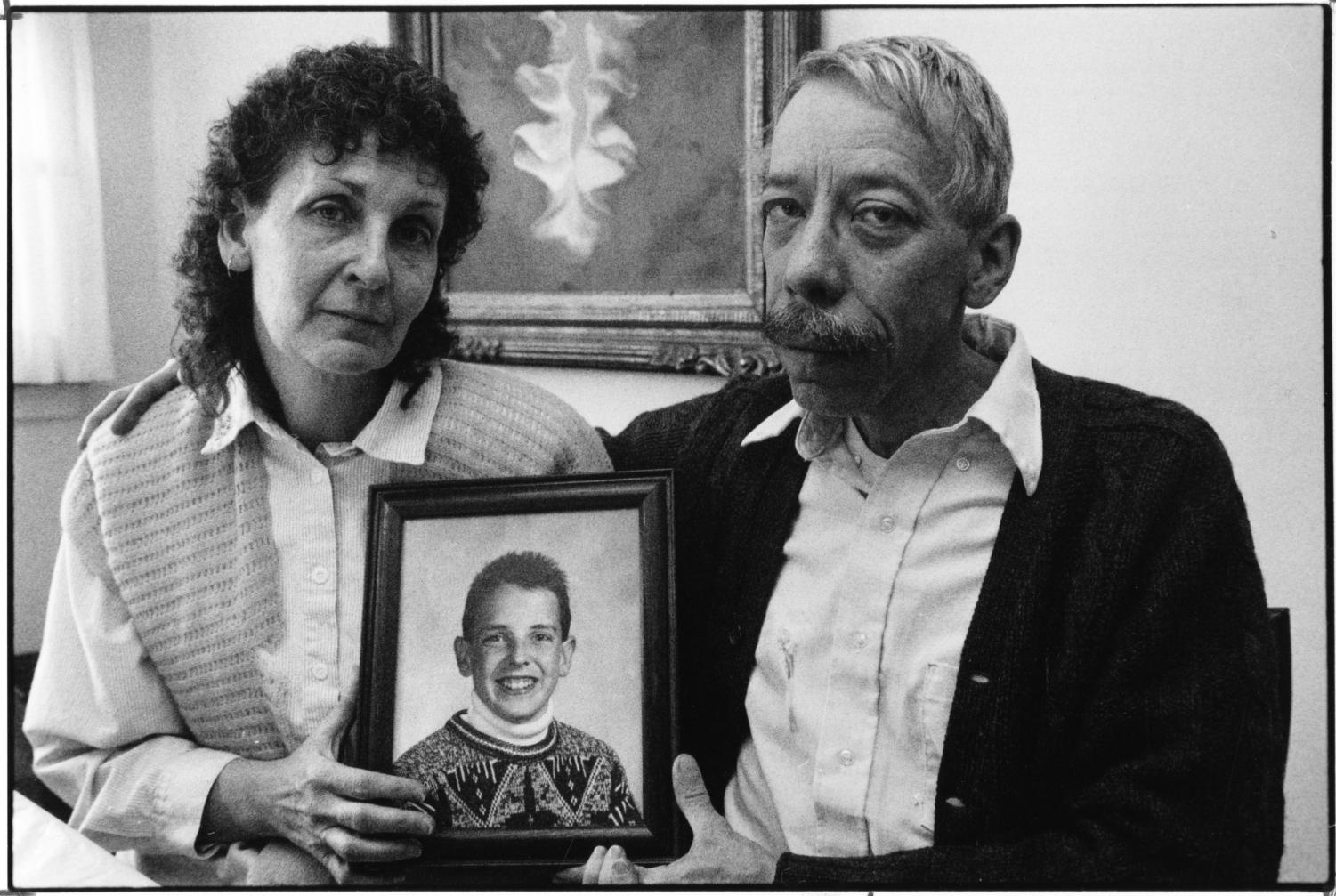 In this Jan. 7, 1992 photo, Esther and Allan Chereck, parents of slain David Chereck, hold a photo of their son during an interview at their home in Skokie, Ill. on Jan. 7, 1992. Eduardo Contreras, Robert Serritella was found guilty Thursday, May 23, 2019 of first-degree murder in the 1992 death of 15-year-old David Chereck. Serritella, 76, of Park Ridge, was charged in 2014 in the decades-old cold case. Chereck was found strangled with his own scarf in a Morton Grove forest preserve.