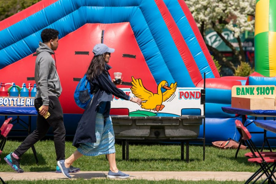 Students walk past an inflatable slide during the DePaul Spring Carnival on the Lincoln Park Quad.