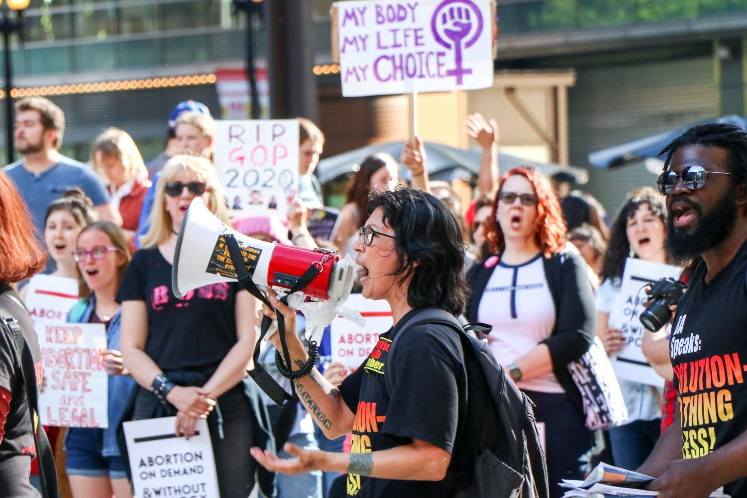 Maya Cruz, a supporter of communist group Revolution Club,  spiritedly addresses the crowd at the pro-choice Chicago Rally for Reproductive Justice on Thursday.