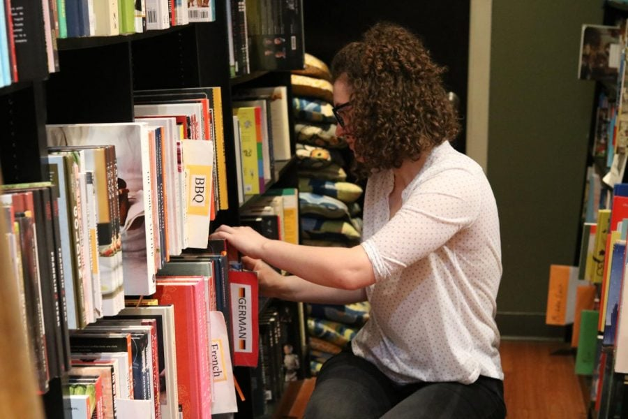A customer looks for a book at The Book Cellar.