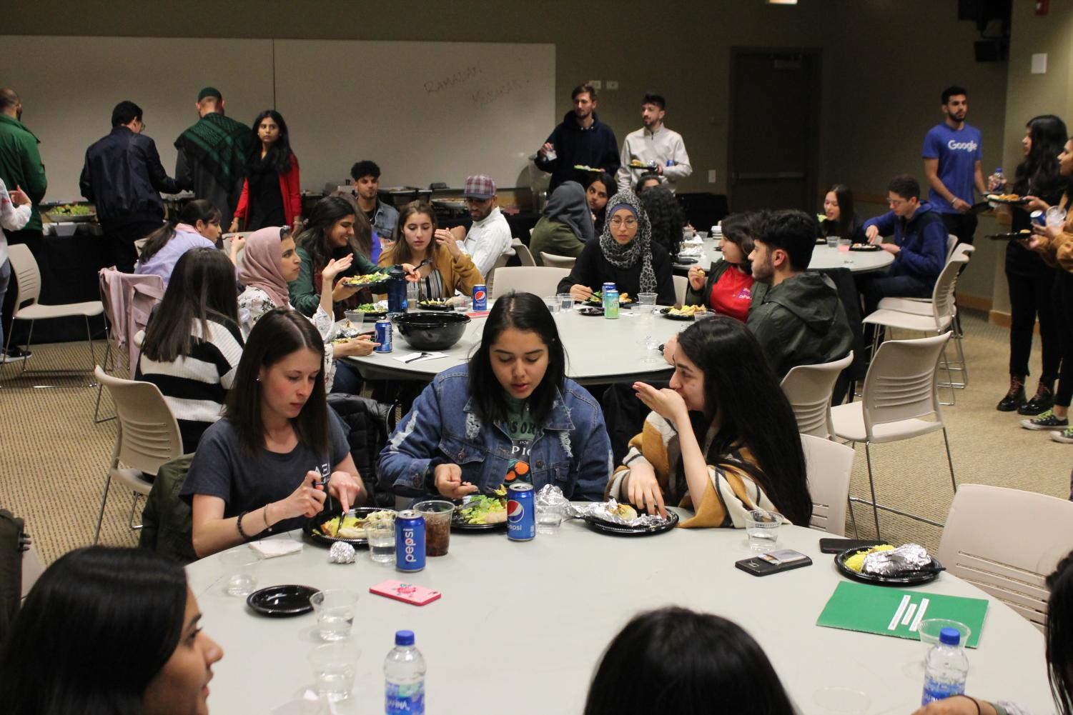 Students talk to one another before breaking fast.