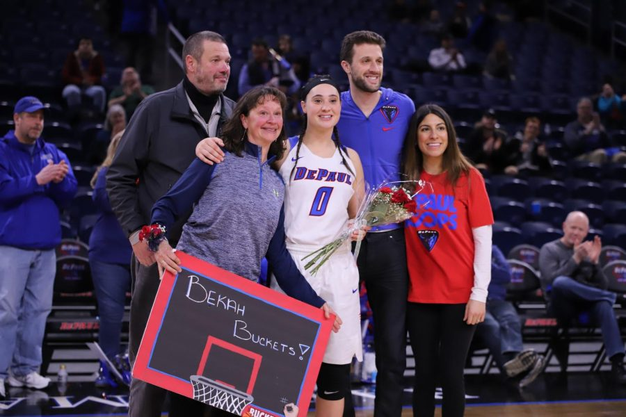 Graduate senior Rebekah Dahlman celebrates with family.