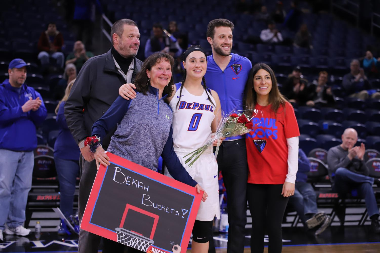 Graduate senior Rebekah Dahlman celebrates with family.