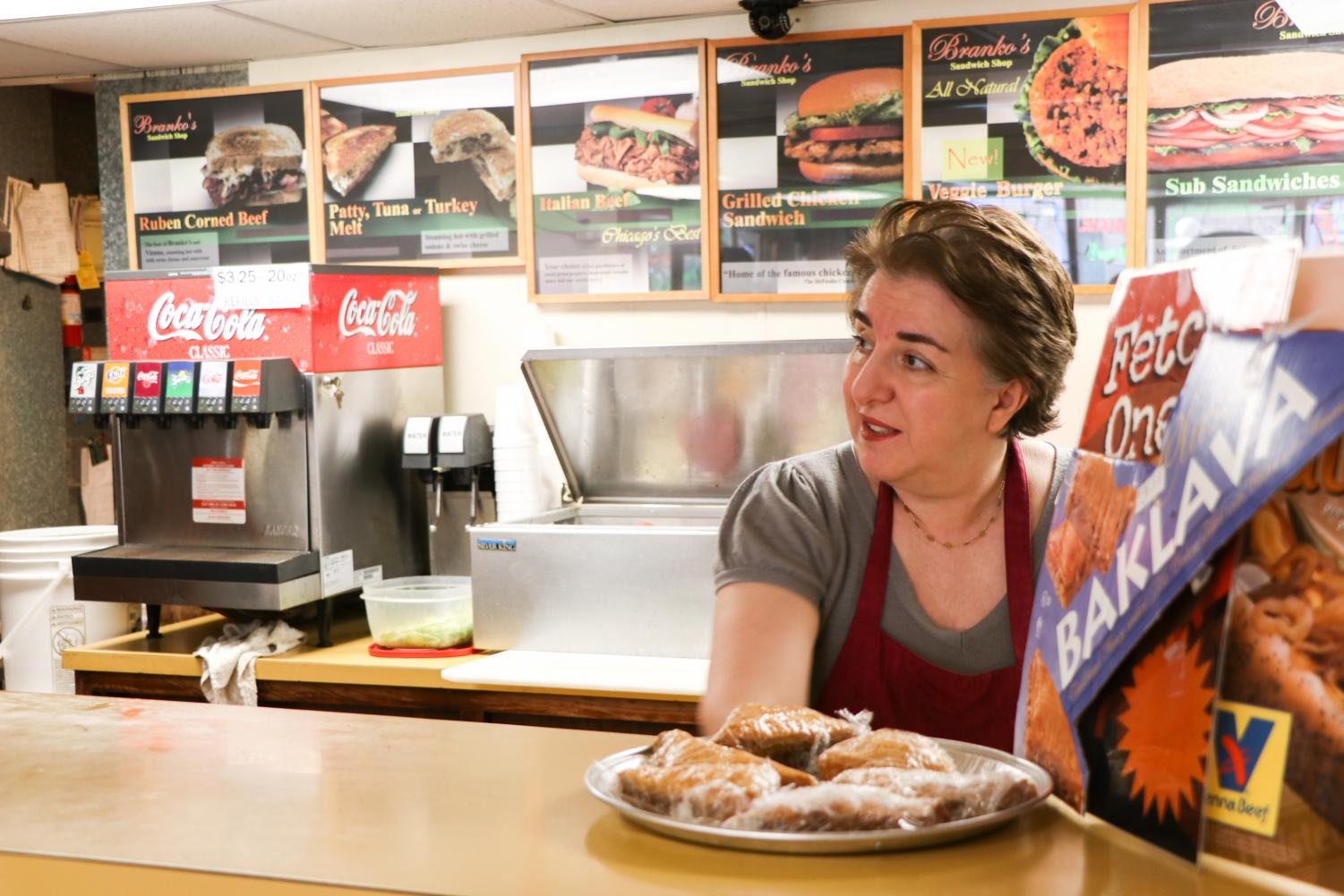 "Branko's sandwich shop owner Anja Branko, known to regular customers as ""Mama,"" staffs the counter at her sandwich shop across from the DePaul's Lincoln Park campus quad on Fullerton Avenue."