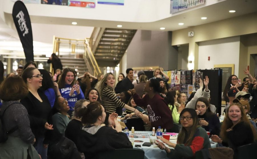 Students celebrate the announcement of Lil Yatchy as the headliner for DePaul Fest. This Fest reveal party was held in the Student Center and Fest 2019 will take place May 24.