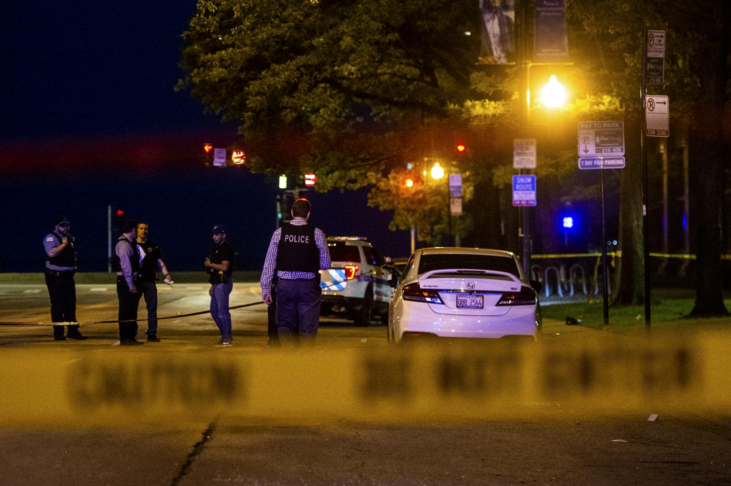 In this Saturday, June 1, 2019 photo, Chicago police investigate the scene where multiple people were shot in the Gold Coast neighborhood of Chicago.
