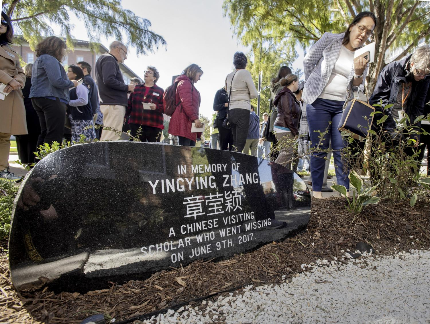 This Oct. 11, 2018, file photo shows guests mingling after a ceremony to dedicate the memorial garden for Yingying Zhang, Chinese scholar who disappeared from campus in June 2017. A judge at the trial of a former University of Illinois student charged with killing a visiting Chinese scholar says lawyers should be ready to deliver opening statements by the middle of next week. Thursday, June 6, 2019, is the fourth day of jury selection at Brendt Christensen's trial in Peoria.