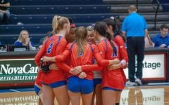 The DePaul volleyball team huddles up during one of their match's at the DePaul Invitational, that took place from Sep. 7-8.