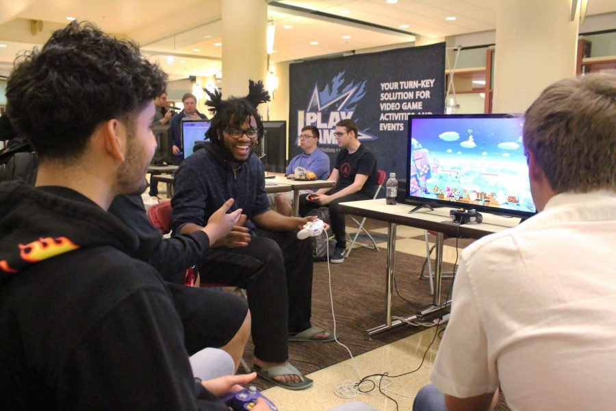 Students congratulate each other playing Smash Bros on the Nintendo Switch during the Gaming Party organized by the DePaul Esports Organization on Tuesday.
