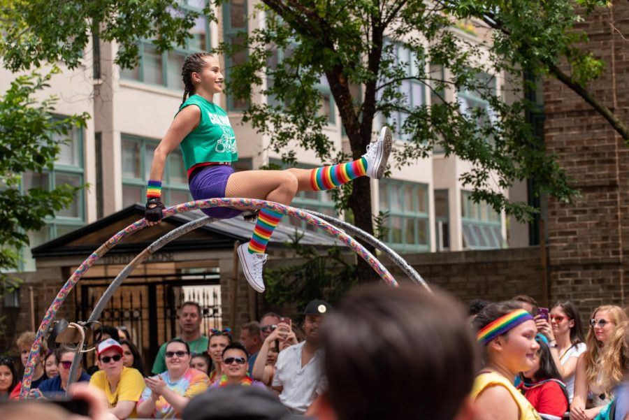 FILE- A parade participant preforms stunts with giant rings at the 2019 Chicago Pride Parade.