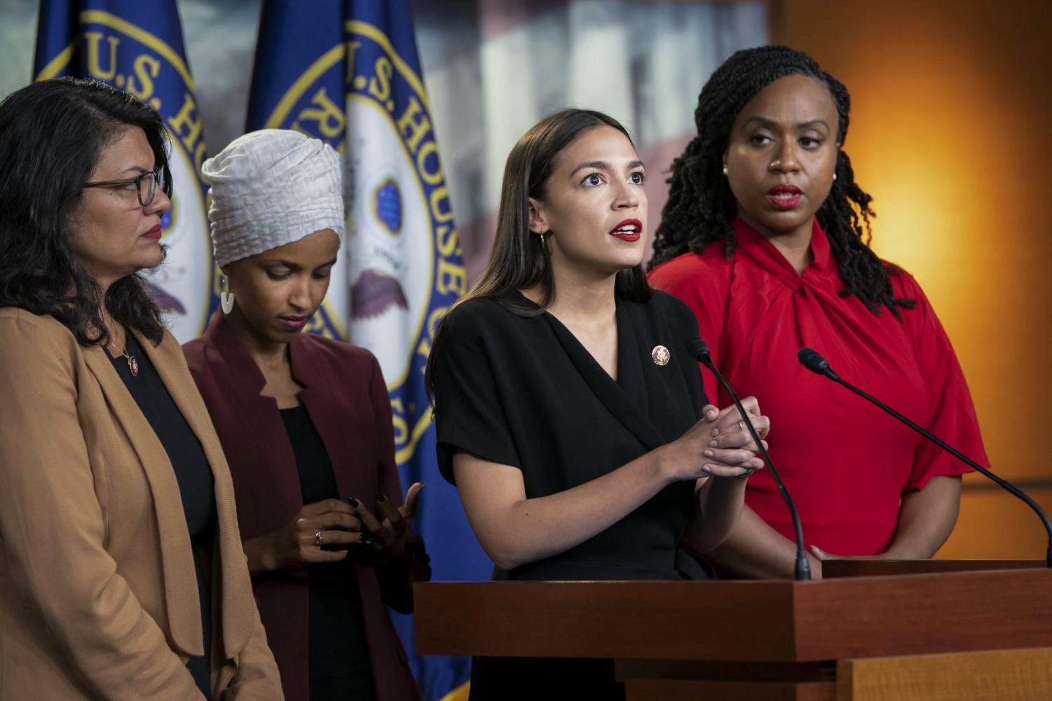 "In this July 15, 2019, file photo, from left, Rep. Rashida Tlaib, D-Mich., Rep. Ilhan Omar, D-Minn., Rep. Alexandria Ocasio-Cortez, D-N.Y., and Rep. Ayanna Pressley, D-Mass., speak at the Capitol in Washington. All are American citizens and three of the four were born in the U.S. President Donald Trump told American congresswomen of color to ""go back"" to where they came from. He later vowed to revive a racial slur to tear down Elizabeth Warren, promoted a wild conspiracy theory linking a past political opponent to the death of a high-profile sex offender and blamed Friday's stock market slide on a low-polling former presidential candidate."
