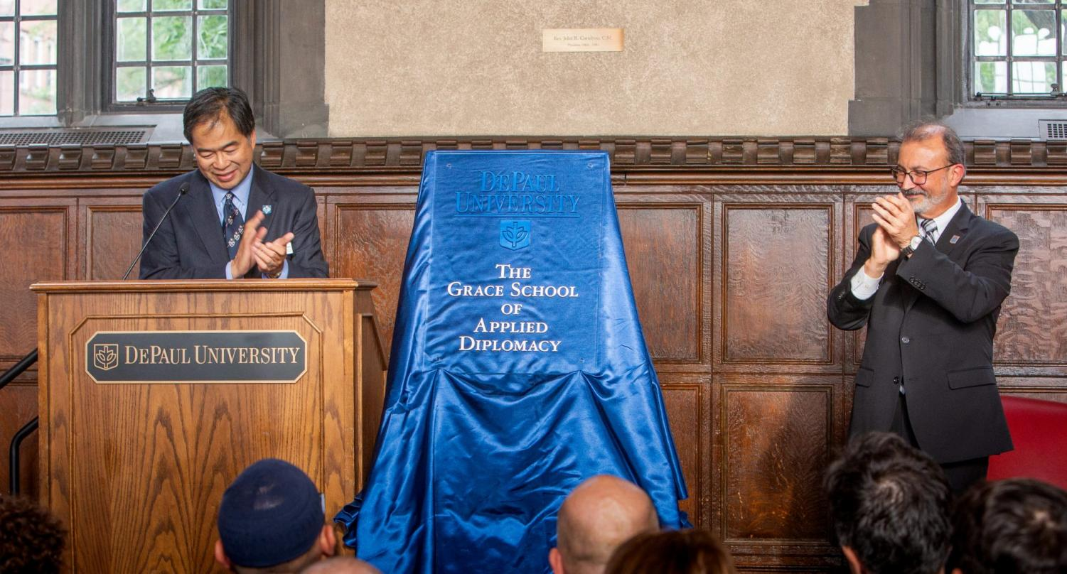 A. Gabriel Esteban, Ph.D., president of DePaul, left and Guillermo Vásquez de Velasco, dean of the College of Liberal Arts and Social Sciences, right.